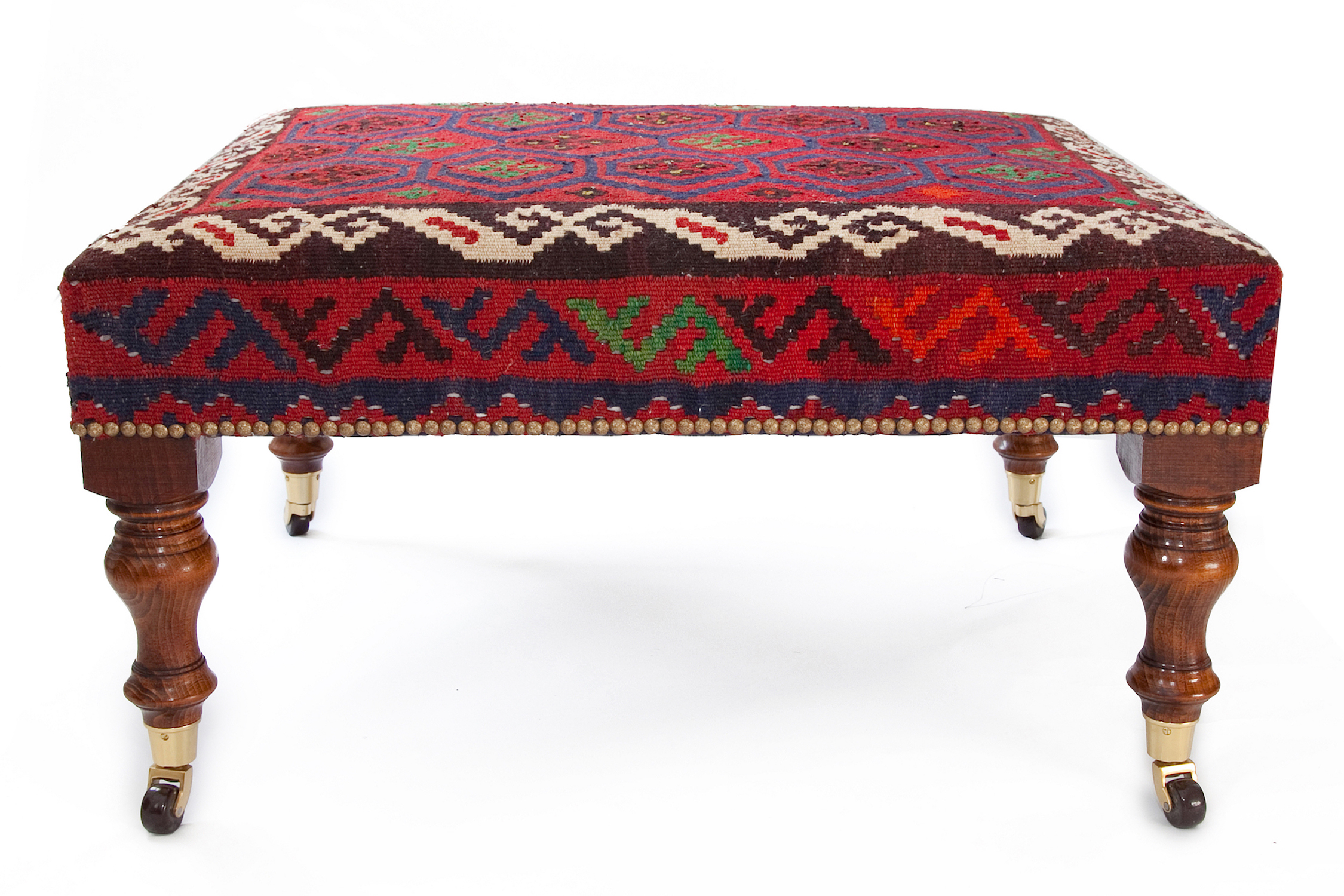 Kilim  Footstool with Speckled Gold Studs and Turned legs with Castors.